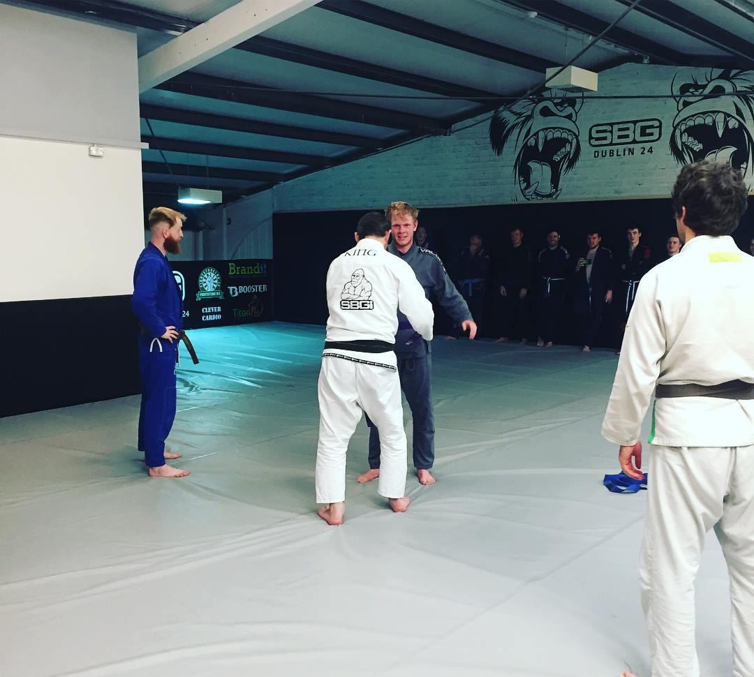 Andy receiving in purple belt in BJJ
