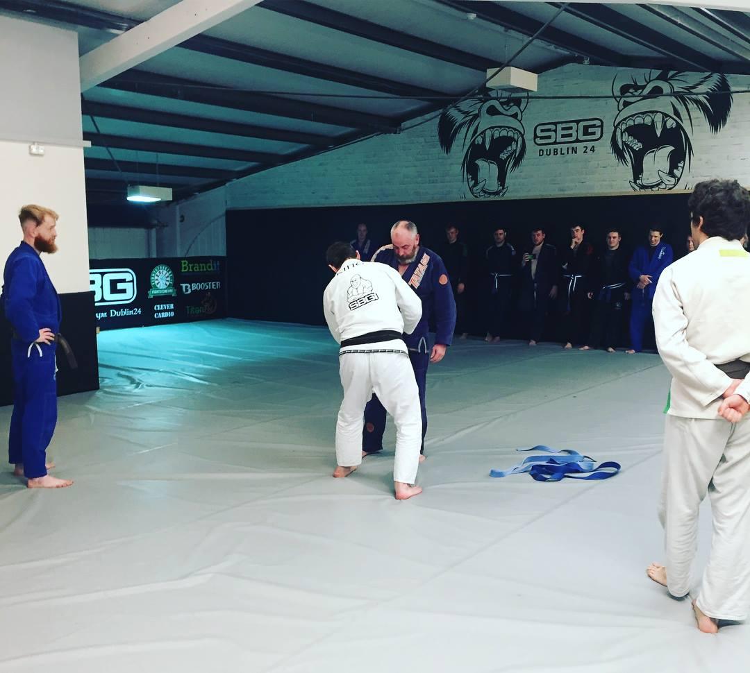 Jimmy receiving his purple belt in BJJ