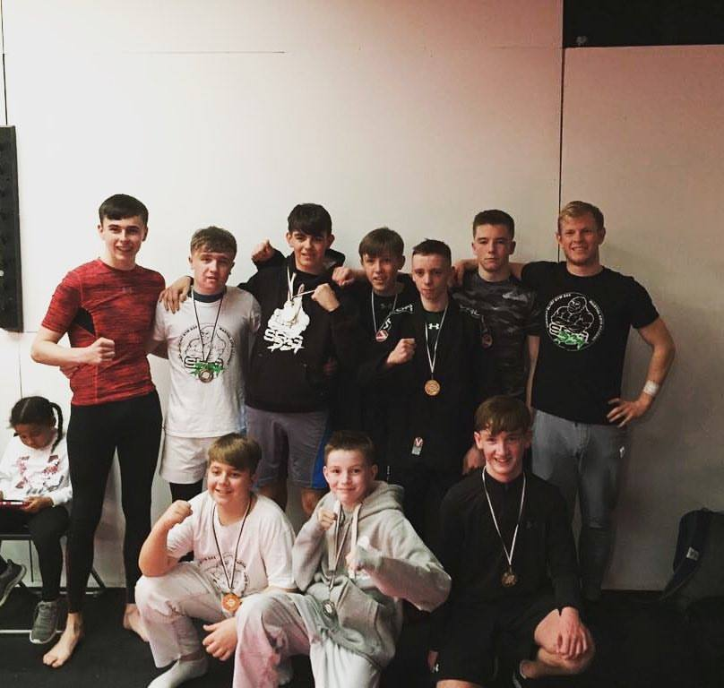 Coach Andy with the silverback team competing in teens BJJ